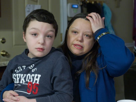 """Ten-year-old Sam Doran's mother, Nicole (right), says that in Jackson schools, Sam """"should be in fifth grade, but he's only doing second-grade level (work)."""""""