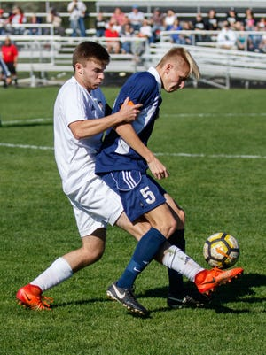 Brookfield East's Calvin Pearson (5) battles for possession with Cedarburg's Braden Voeller during the match at Cedarburg on Saturday, Oct. 21, 2017.