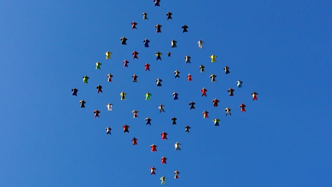Wingsuit skydivers set a  world record for the largest aerial formation in the sky over Perris, Calif.