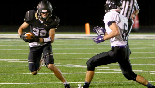 Franklin's Elliot Harris veers from Indian Trail's Evan Callow at Franklin on Sept. 29.