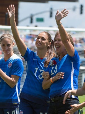 USA forward Alex Morgan (13, left) waves to the crowd with her mom Pamela Morgan before the game against Ireland at Avaya Stadium on May 10.