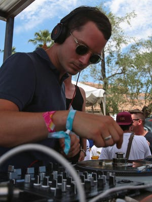 Elijah Wood performs with Zach Cowie (not pictured) as DJ duo Wooden Wisdom during the Splash House music festival and pool party on Sunday, August 10, 2014 at Hacienda Cantina & Beach Club in Palm Springs, Calif.