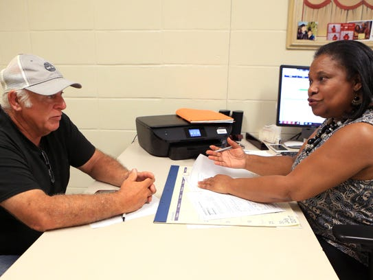 Randall Whiting meets with Deborah Henry, a certified
