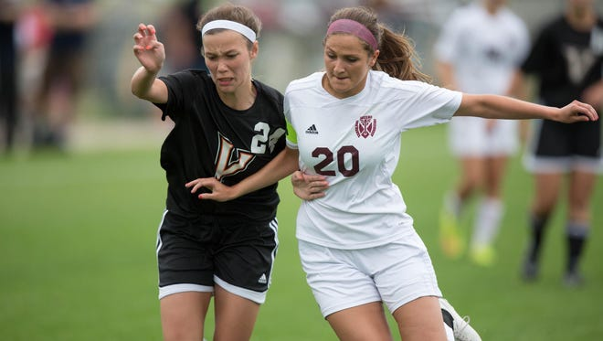 Dowling High School's Bailey Bravard and Valley's Haley Waseskuk battle for the ball during the first half Friday, June 12, 2015, during the IGHSAU State Soccer Championships at the Cownie Soccer Complex in Des Moines.