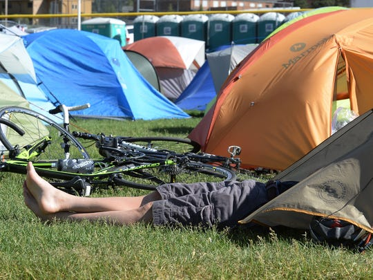 A cyclist relaxes after riding from Grand Lake to the Ride the Rockies camp in Estes Park on Thursday, June 16, 2016.