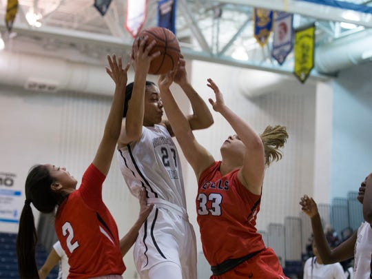 Rutgers Prep's Jahsyni Knight gets double pressure from Saddle River's Carolyn Carrera and Jenna Jordan as she comes down with a rebound. Rutgers Prep vs Saddle River Day girls basketball in NJSIAA Non-Public B Girls final in Toms River on March 10, 2018