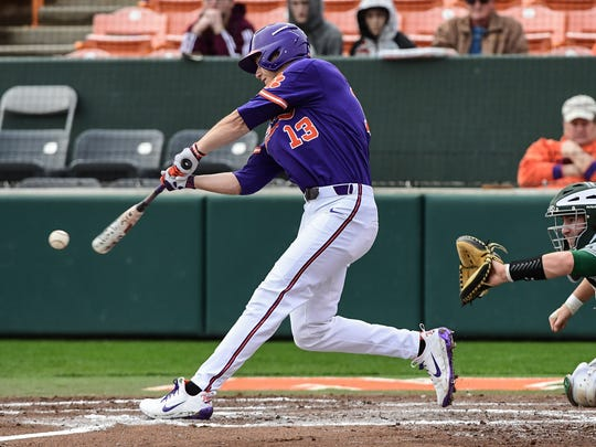 Clemson senior outfielder Drew Wharton (13) swings against William and Mary during the bottom of the third inning on Saturday at Doug Kingsmore Stadium in Clemson.