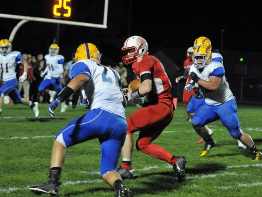 Port Clinton quarteback Brandon Moore (#5) runs deep