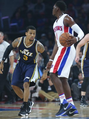 Pistons guard Reggie Jackson drives against Jazz guard Trey Burke during the first quarter of the Pistons' 92-87 win Wednesday, October 28, 2015 at the Palace.