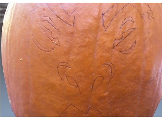 After removing the template, take a pen and darken in the grooves for ease in carving.