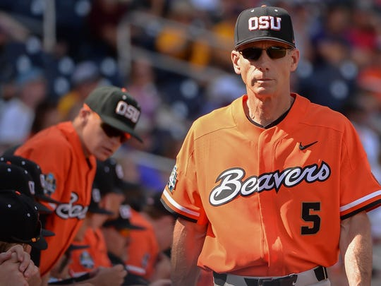 Oregon State Beavers head coach Pat Casey (5) walks in front of the dugout in the ninth inning against the LSU Tigers at TD Ameritrade Park Omaha. Mandatory Credit: Steven Branscombe-USA TODAY Sports