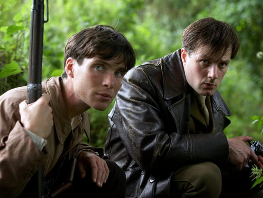 Cillian Murphy as Damien and Pádraic Delaney as Teddy