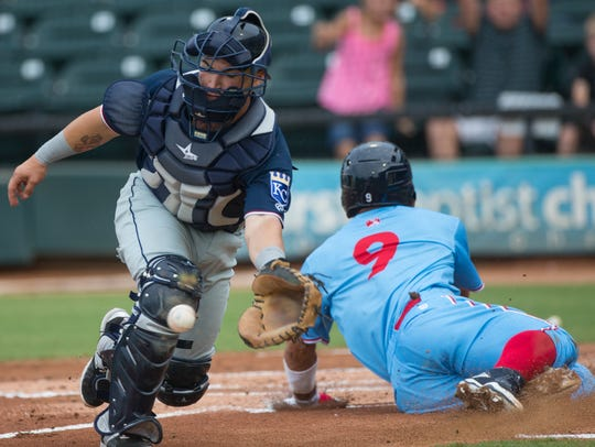 Corpus Christi's Ramon Laureano slides home to score before Northwest Arkansas Naturals' Nick Dini catches the ball during the first inning of a 2017 game at Whataburger Field.