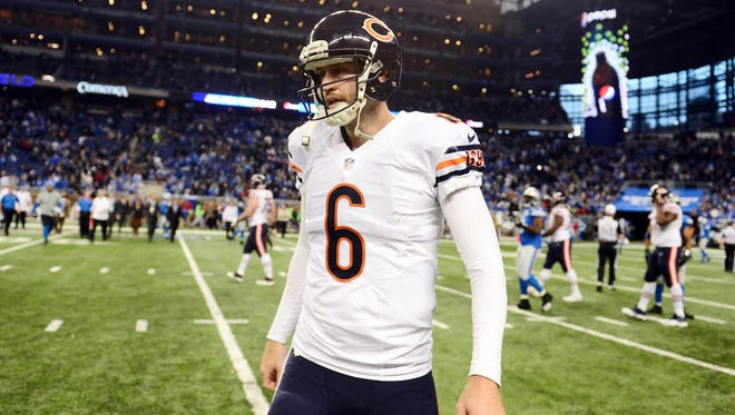 Chicago Bears quarterback Jay Cutler walks off the field after being defeated by the Detroit Lions, 34-17.