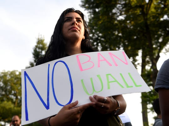 "Abire Sabbagh of Paterson attends  a rally outside of the Islamic Center of Passaic County in Paterson tonight protesting the Supreme Court ruling upholding President Trump's travel ban on Tuesday, June 26, 2018. With a 5-4 vote, the court wrote in its opinion that the order is ""squarely within the scope of Presidential authority."""