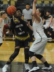 Abilene High's Maya Taylor, left, eyes the basket while Clyde's Cierra Bryan defends.