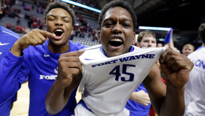 IPFW center Brent Calhoun (45) celebrates a 71-68 win over Indiana in overtime Tuesday in Fort Wayne, Ind.