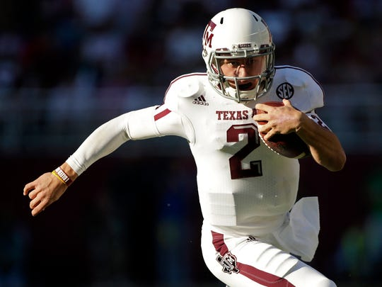 FILE - Johnny Manziel could be the answer to Cleveland's prayers at quarterback. The polarizing and popular Texas A&M star will likely be available when the Browns pick fourth in next week's NFL draft.