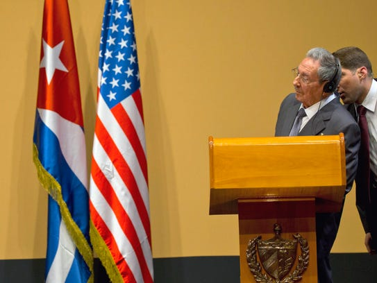 President Obama speaks as and Cuba's President Raul