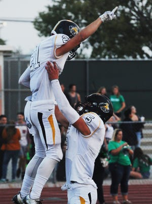 Broc Mortensen, left, and Brandon Gooding hope Ventura can do some more celebrating when the unbeaten Cougars visit Rio Mesa on Friday night.