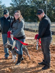 Marine Cpl. Trevor Snyder, right, and his fiance, Cloey, ceremonially break ground on a new home being built for them by Operation Finally Home and K.W. Homes. Snyder was injured when an improvised explosive device exploded near his Humvee while serving in Iraq.