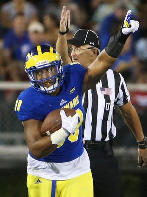 Delaware defensive lineman Cam Kitchen celebrates his fumble recovery in the third quarter of Delaware's 22-3 win at Delaware Stadium.