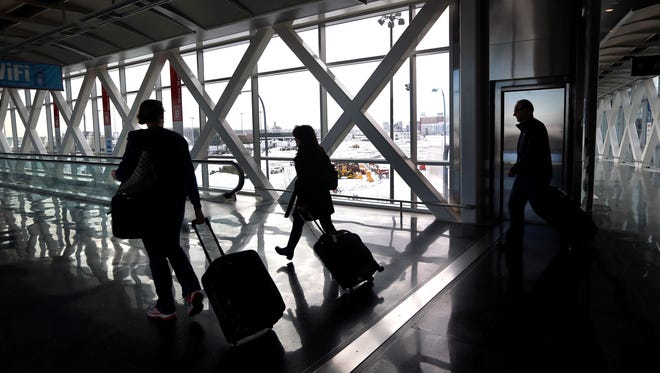 Travelers move through Logan International Airport in Boston Wednesday, Jan. 28, 2015, as it begins to resume normal operations   from last week's storm.