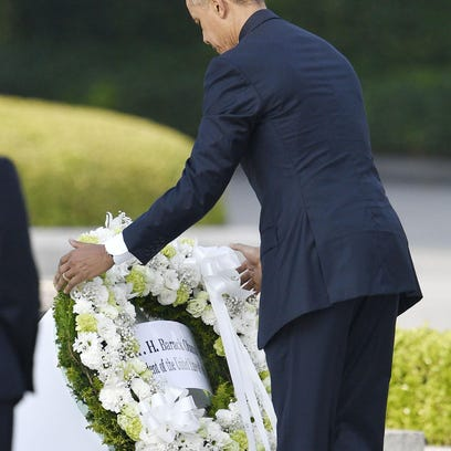 President Barack Obama, whose staff shapes the administration's narrative about his foreign policy, lays a wreath at Hiroshima Peace Memorial Park in Hiroshima on Friday while visiting Japan. He used the visit to renew his call for an end to nuclear weapons.