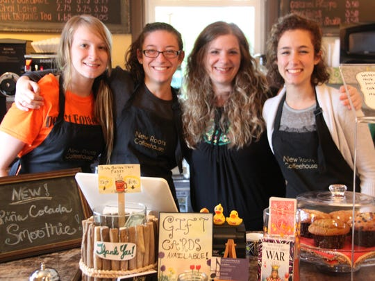 From left, Kerrianne Buduson, Rebecca Luttrell, owner Aria Matthews and Beverly Cranston at work at New Roots Coffeehouse, 1273 Long Pond Road in Greece.