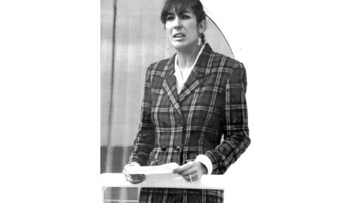 """FILE - In this Nov. 7, 1991, file photo Ghislaine Maxwell, daughter of late British publisher Robert Maxwell, reads a statement in Spanish in which she expressed her family's gratitude to the Spanish authorities, aboard the """"Lady Ghislaine"""" in Santa Cruz de Tenerife. Maxwell, a British socialite who was accused by many women of helping procure underage sex partners for Jeffrey Epstein, has been arrested in New Hampshire, the FBI said Thursday, July 2, 2020."""