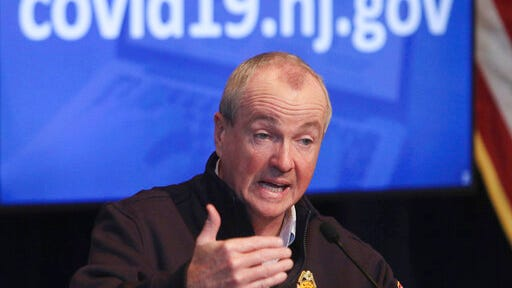 FILE- In this April 25, 2020 file photo, New Jersey Gov. Phil Murphy speaks during his daily press briefing at the the War Memorial in Trenton, N.J. Murphy signed legislation on Thursday, July 16, 2020, authorizing nearly $10 billion in debt to plug budget holes brought on by the coronavirus pandemic, but Republicans sued him, arguing the bill runs afoul of the state constitution.