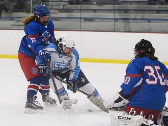 South Burlington's Claire Wright (8) battles for the