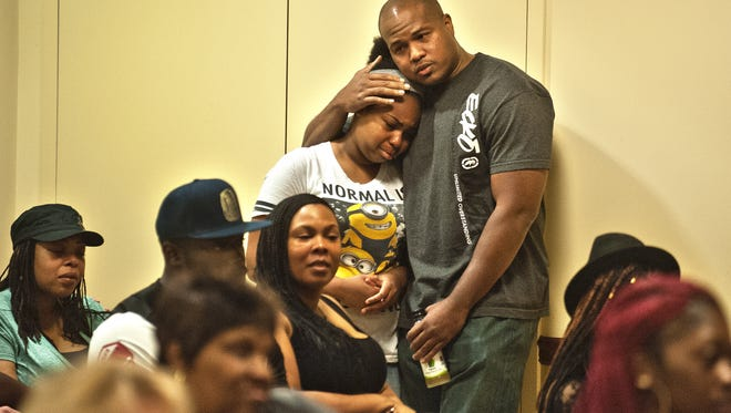 Antwan Timbers Sr., father of late Antwan L. Timbers Jr.,  embraces with daughter  Aniya Timbers minutes before a press conference regarding the death of their love one by an alleged drunk driver in Burlington City.