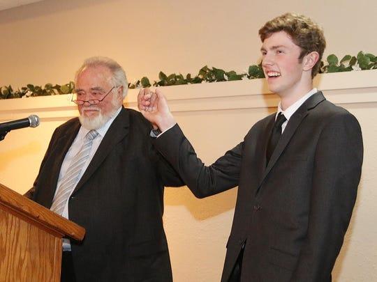 Herbert V. Kohler, Jr. raises the arm of Random Lake