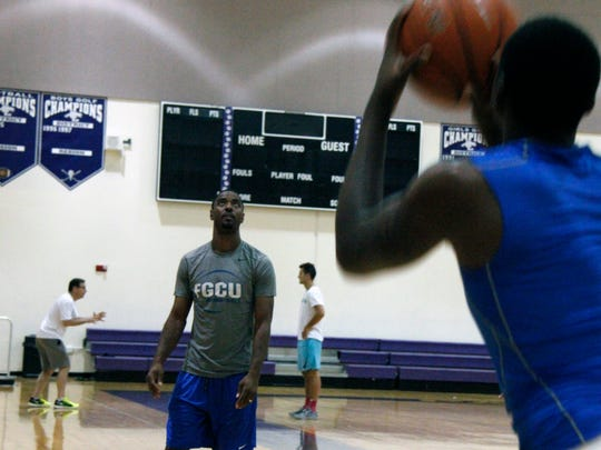 FGCU assistant coach Aaron Miles looks on during the men's basketball team's practice at Cypress Lake High School on Wednesday, July 27, 2016.