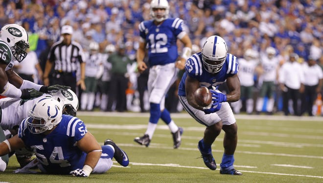 Indianapolis Colts running back Frank Gore (23) looses control of the ball, ultimately giving the ball up to the Jets on the fumble at the goal line, during the second half of a NFL Monday Night Football game, Monday, September 21, 2015.