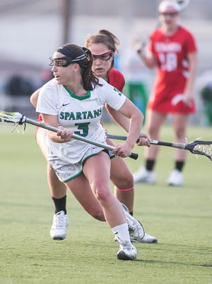 Rachel Saks (3) and the York College women's lacrosse team enter this week's CAC Tournament as the top seed after going a perfect 8-0 in league play this season. Amanda J. Cain photo