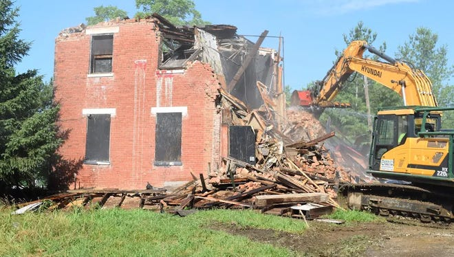 The historic St. Rita School for the Deaf building gets torn down.