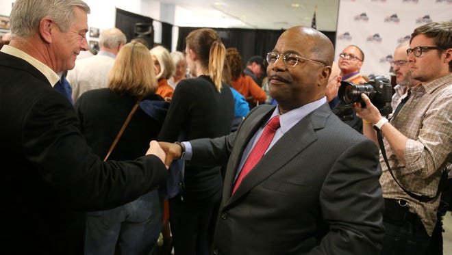 James Sheppard is congratulated as he walks through a crowd after announcing he will run for mayor of the City of Rochester.