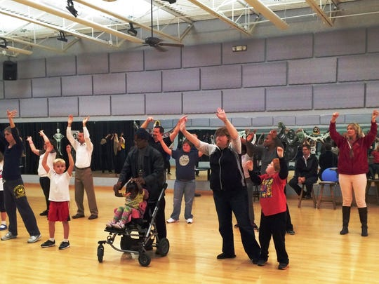 The Miracle League dancers at rehearsal in preparation for their performance at the Cheers Gala. The group practices at Fred Astaire Dance Studios in Bloomfield Township.