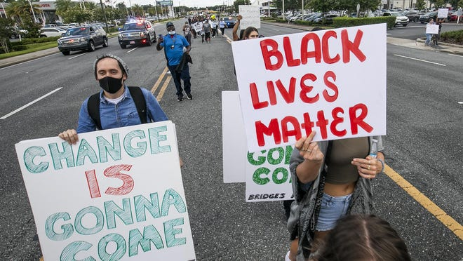 When demonstrators took off down the center of State Road 200 on Sunday, the Ocala Police Department reacted quickly and flanked the marchers to protect them.