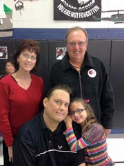 In this Nov. 14, 2014 photo, Ryan McDermott is pictured with his parents Linda and Jerry along with his daughter Hope.