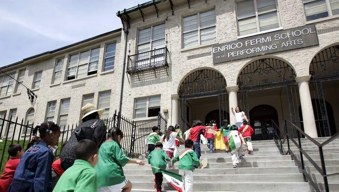 Kindergarten students enter Enrico Fermi Elementary School in Yonkers.