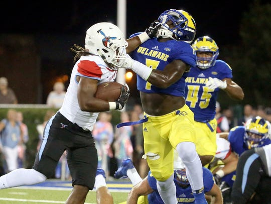 Delaware State running back Brycen Alleyne is stopped