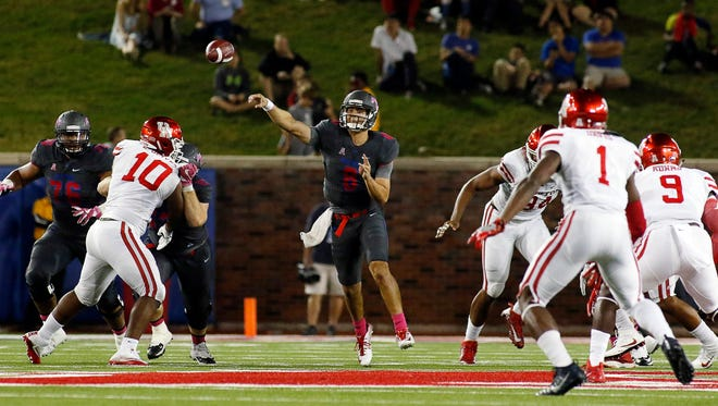 Oct 22, 2016; Dallas, TX, USA; SMU Mustangs quarterback Ben Hicks (8) passes against the Houston Cougars during the second quarter at Gerald J. Ford Stadium. Mandatory Credit: Ray Carlin-USA TODAY Sports