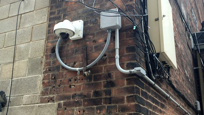 A Bedrock Real Estate Services security camera that is mounted at the rear of the Detroit Beer Co. on Broadway facing an alley in downtown Detroit.