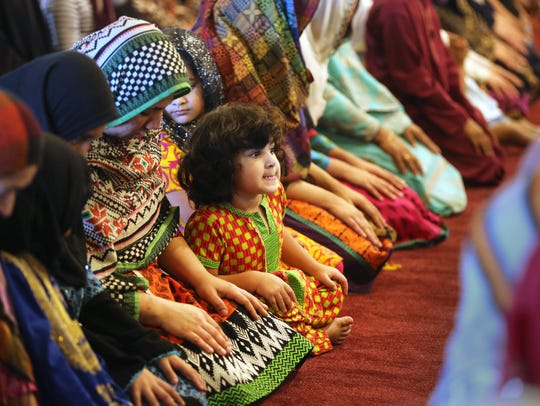 Naina Iqbal, 3, during prayer service at the Islamic