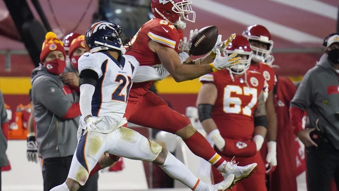 Denver Broncos cornerback A.J. Bouye (21) breaks up a pass intended for Kansas City Chiefs tight end Travis Kelce (87) in the second half of a game Sunday in Kansas City, Mo.