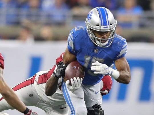 Golden Tate runs for a first down against the Cardinals