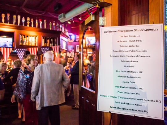 A list of sponsors sits outside a reception for Delaware delegates at Chickie's and Pete's in Philadelphia on Wednesday.